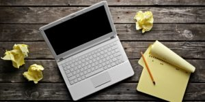 bigstock-Laptop-with-blank-notepad-and-35817068